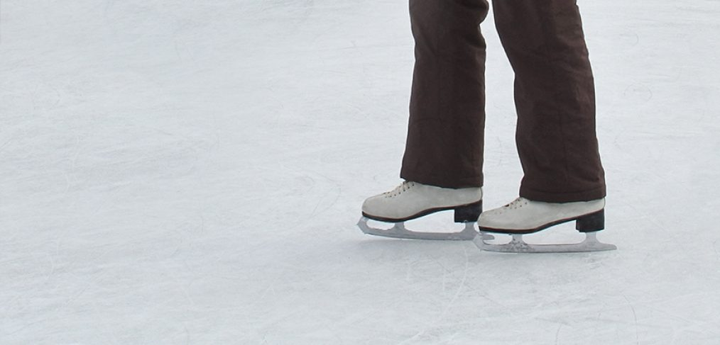a woman skating on an outdoor rink